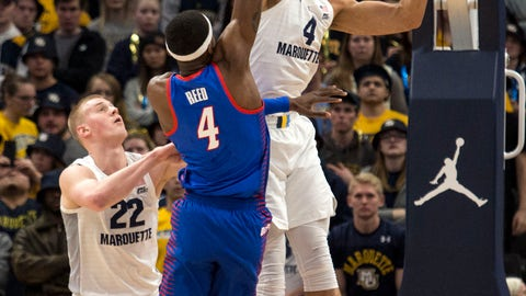 <p>               DePaul forward Paul Reed, center, goes up for a basket against Marquette forward Theo John, right, during the first half of an NCAA college basketball game, Wednesday, Jan. 23, 2019, in Milwaukee. (AP Photo/Darren Hauck)             </p>