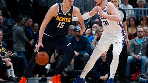 <p>               Denver Nuggets center Nikola Jokic, left, works the ball inside as Philadelphia 76ers forward Mike Muscala defends during the first half of an NBA basketball game Saturday, Jan. 26, 2019, in Denver. (AP Photo/David Zalubowski)             </p>
