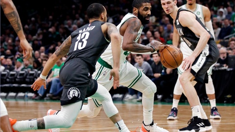 <p>               Boston Celtics guard Kyrie Irving, center, drives between Brooklyn Nets guard Shabazz Napier (13) and forward Rodions Kurucs (00) during the second half of an NBA basketball game in Boston, Monday, Jan. 7, 2019. (AP Photo/Charles Krupa)             </p>