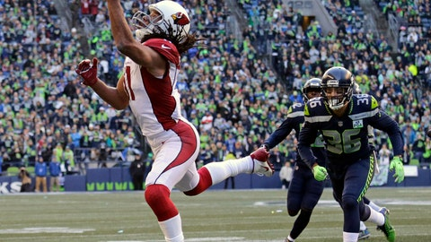 """<p>               FILE - In this Dec. 30, 2018, file photo, Arizona Cardinals' Larry Fitzgerald, left, snags a one-handed touchdown pass against the Seattle Seahawks during the first half of an NFL football game, in Seattle. Star receiver Larry Fitzgerald is returning to the Arizona Cardinals for a 16th NFL season. The Cardinals announced Wednesday, Jan. 23, 2019, that they signed the 35-year-old Fitzgerald to a one-year contract. Team president Michael Bidwell says, """"No player has meant more to this franchise or this community than Larry Fitzgerald.""""(AP Photo/John Froschauer, File)             </p>"""
