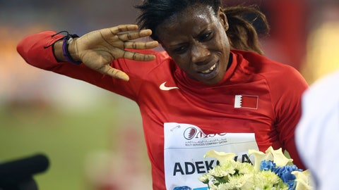 """<p>               FILE - In this Friday, May 9, 2014 file photo, Kemi Adekoya of Bahrain gestures after winning the 400m hurdles at the IAAF Diamond League in the Qatari capital Doha. Four-time Asian Games champion Kemi Adekoya has been provisionally suspended after testing positive for an anabolic steroid. The Athletics Integrity Unit says a """"notice of allegation"""" was sent to Adekoya. She is a Nigerian-born runner who switched allegiance to Bahrain. (AP Photo/Osama Faisal, File)             </p>"""