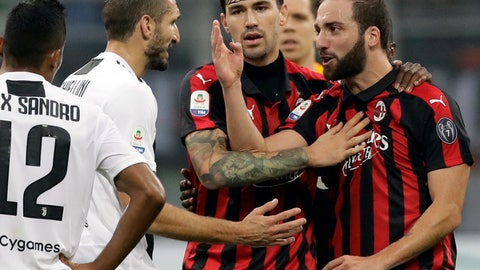 <p>               FILE - In this Nov. 11, 2018 file photo, AC Milan's Gonzalo Higuain, right, talks with Juventus' Giorgio Chiellini, during a Serie A soccer match between AC Milan and Juventus, at Milan's San Siro stadium.The Italian Super Cup is normally looked upon as little more than a friendly, the traditional curtain-raiser to a season. But this year it is being played against a backdrop of political outrage and protests. Italian politicians and human rights activists have objected to the game being played in Saudi Arabia, citing the assassination of Washington Post columnist Jamal Khashoggi at the Saudi Consulate in Istanbul, Turkey. (AP Photo/Luca Bruno)             </p>