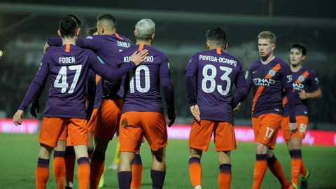 <p>               Manchester City's Sergio Aguero, 10, celebrates scoring his side's first goal with teammates including Manchester City's Kevin De Bruyne, second right, during the English League Cup semifinal soccer match between Burton Albion and Manchester City at Pirelli Stadium in Burton on Trent, England, Wednesday, Jan. 23, 2019. (AP Photo/Rui Vieira)             </p>