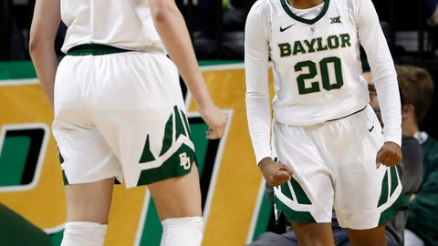 <p>               Baylor forward Lauren Cox (15) watches as guard Juicy Landrum (20) celebrates after scoring a basket and being fouled on the play by Iowa State in the first half of an NCAA college basketball game in Waco, Texas, Wednesday, Jan. 23, 2019. (AP Photo/Tony Gutierrez)             </p>