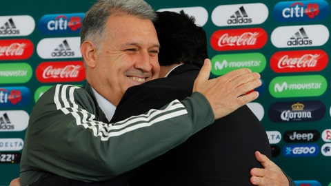 <p>               Gerardo Martino is presented as the new coach of Mexico's national soccer team, during a news conference in Mexico City, Monday, Jan. 7, 2019. At right is Yon De Luisa, president of the Mexican Football Federation. (AP Photo/Marco Ugarte)             </p>
