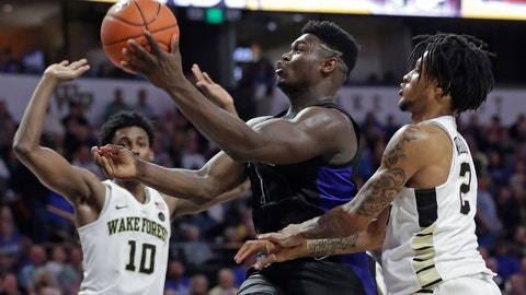 <p>               Duke's Zion Williamson, center, drives between Wake Forest's Jaylen Hoard, left, and Sharone Wright Jr. during the second half of an NCAA college basketball game in Winston-Salem, N.C., Tuesday, Jan. 8, 2019. (AP Photo/Chuck Burton)             </p>