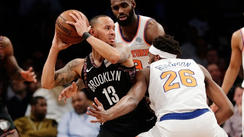 <p>               Brooklyn Nets' Shabazz Napier (13) keeps the ball away from New York Knicks' Mitchell Robinson (26) and Tim Hardaway Jr. (3) during the first half of an NBA basketball game Friday, Jan. 25, 2019, in New York. (AP Photo/Frank Franklin II)             </p>