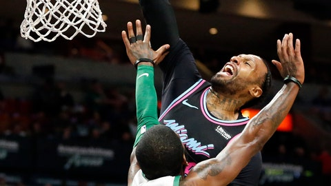 <p>               Miami Heat forward James Johnson, top, goes to the basket against Boston Celtics guard Kyrie Irving (11) during the first half of an NBA basketball game, Thursday, Jan. 10, 2019, in Miami. (AP Photo/Joel Auerbach)             </p>