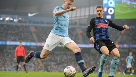 <p>               Manchester City's Kevin De Bruyne, left crosses the ball under pressure from Rotherham's Ben Wiles during the English FA Cup third round soccer match between Manchester City and Rotherham United at Etihad stadium in Manchester, England, Sunday, Jan. 6, 2019. (AP Photo/Rui Vieira)             </p>