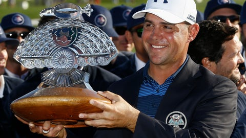 <p>               FILE- In this Feb. 4, 2018, file photo, Gary Woodland smiles for photographers with the championship trophy after winning the Waste Management Phoenix Open golf tournament in Scottsdale, Ariz. Woodland won the 2018 Phoenix Open for his first victory in five years. He returns to the desert this weekend, hoping to defend his title at the Greatest Show on Turf. (AP Photo/Ross D. Franklin, File)             </p>