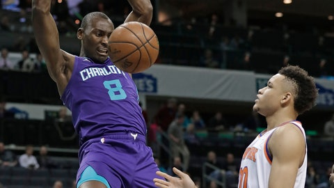 <p>               Charlotte Hornets' Bismack Biyombo (8) dunks against New York Knicks' Kevin Knox (20) during the first half of an NBA basketball game in Charlotte, N.C., Monday, Jan. 28, 2019. (AP Photo/Chuck Burton)             </p>