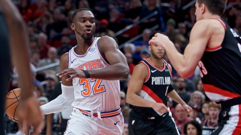 <p>               New York Knicks forward Noah Vonleh, left, drives to the basket in front of Portland Trail Blazers forward Zach Collins during the first half of an NBA basketball game in Portland, Ore., Monday, Jan. 7, 2019. (AP Photo/Craig Mitchelldyer)             </p>
