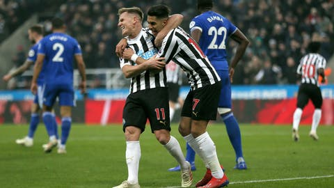 <p>               Newcastle United's Matt Ritchie, left, and Ayoze Perez celebrate their side's first goal of the game, scored by teammate Fabian Schar (not pictured) during, during their English Premier League soccer match at St James' Park in Newcastle, England, Saturday Jan. 19, 2019. (Richard Sellers/PA via AP)             </p>