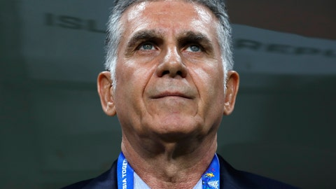<p>               Iran's head coach Carlos Queiroz waits for the start of the AFC Asian Cup group D soccer match between Iran and Yemen at the Mohammed Bin Zayed Stadium in Abu Dhabi, United Arab Emirates, Monday, Jan. 7, 2019. (AP Photo/Hassan Ammar)             </p>