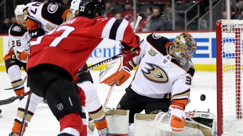<p>               A shot by New Jersey Devils center Pavel Zacha (37), of the Czech Republic, gets by Anaheim Ducks goaltender John Gibson (36) but does not enter the goal during the second period of an NHL hockey game, Saturday, Jan. 19, 2019, in Newark, N.J. (AP Photo/Julio Cortez)             </p>