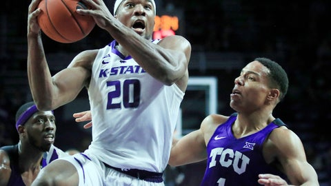 <p>               Kansas State forward Xavier Sneed (20) drives past TCU guard Desmond Bane (1) during the second half of an NCAA college basketball game in Manhattan, Kan., Saturday, Jan. 19, 2019. Sneed scored 18 points in the game. Kansas State defeated TCU 65-55. (AP Photo/Orlin Wagner)             </p>