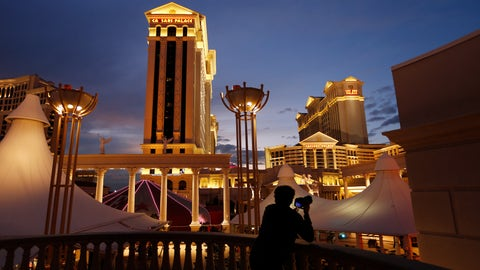 <p>               FILE - In this Monday, Jan. 12, 2015, file photo, a man takes pictures of Caesars Palace hotel and casino, in Las Vegas. The NFL is partnering with Caesars Entertainment as its first official casino sponsor, but the deal does not include sports betting or fantasy football. The multiyear arrangement announced Thursday, Jan. 3, 2019, begins with this weekend's playoffs. (AP Photo/John Locher, File)             </p>