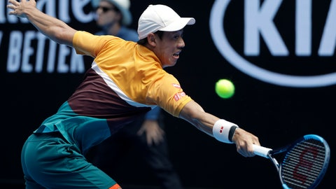 <p>               Japan's Kei Nishikori makes a backhand return to Poland's Kamil Majchrzak during their first round match at the Australian Open tennis championships in Melbourne, Australia, Tuesday, Jan. 15, 2019. (AP Photo/Mark Schiefelbein)             </p>