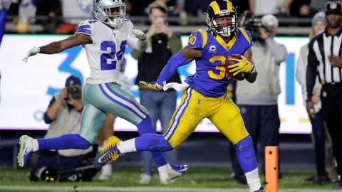 <p>               Los Angeles Rams running back Todd Gurley scores past Dallas Cowboys cornerback Chidobe Awuzie during the first half in an NFL divisional football playoff game Saturday, Jan. 12, 2019, in Los Angeles. (AP Photo/Jae C. Hong)             </p>