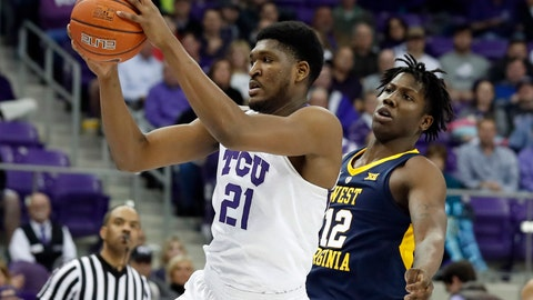 <p>               TCU center Kevin Samuel (21) grabs a pass in front of West Virginia forward Andrew Gordon (12) in the first half of an NCAA college basketball game, Tuesday, Jan. 15, 2019, in Fort Worth, Texas. (AP Photo/Tony Gutierrez)             </p>