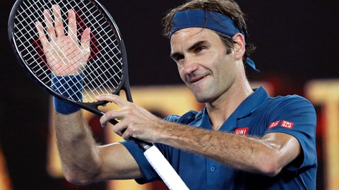 <p>               Switzerland's Roger Federer celebrates after defeating United States' Taylor Fritz during their third round match at the Australian Open tennis championships in Melbourne, Australia, Friday, Jan. 18, 2019. (AP Photo/Kin Cheung)             </p>