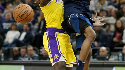 <p>               Minnesota Timberwolves' Andrew Wiggins tries to pass the ball over Los Angeles Lakers' Lance Stephenson in the first half of an NBA basketball game Sunday, Jan. 6, 2019, in Minneapolis. (AP Photo/Stacy Bengs)             </p>