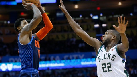<p>               Oklahoma City Thunder forward Paul George (13) shoots over Milwaukee Bucks forward Khris Middleton (22) in the first half of an NBA basketball game in Oklahoma City, Sunday, Jan. 27, 2019. (AP Photo/Sue Ogrocki)             </p>