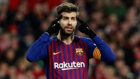 <p>               FC Barcelona's Gerard Pique gestures during a Spanish Copa del Rey soccer match between Sevilla and FC Barcelona at the Ramon Sanche Pizjuan stadium in Seville, Spain, Wednesday Jan. 23, 2019. (AP Photo/Miguel Morenatti)             </p>