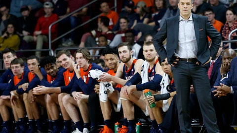 <p>               FILE - In this Wednesday, Jan. 9, 2019, file photo, Virginia head coach Tony Bennett stands at the bench during the first half of an NCAA basketball game against Boston College, in Boston. The fourth-ranked Cavaliers face No. 9 Virginia Tech and No. 1 Duke the week of Jan. 14. (AP Photo/Mary Schwalm, File)             </p>