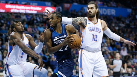 <p>               Minnesota Timberwolves forward Andrew Wiggins (22) drives between Oklahoma City Thunder forward Jerami Grant (9) and center Steven Adams (12) in the first half of an NBA basketball game in Oklahoma City, Tuesday, Jan. 8, 2019. (AP Photo/Sue Ogrocki)             </p>