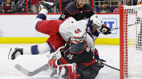 <p>               Carolina Hurricanes goalie Curtis McElhinney (35) blocks Columbus Blue Jackets' Anthony Duclair (91) while Hurricanes' Calvin de Haan (44) watches during the first period of an NHL hockey game in Raleigh, N.C., Friday, Jan. 4, 2019. (AP Photo/Gerry Broome)             </p>