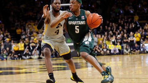 <p>               Michigan State guard Cassius Winston (5) drives past Iowa guard Isaiah Moss (4) during the first half of an NCAA college basketball game Thursday, Jan. 24, 2019, in Iowa City, Iowa. (AP Photo/Charlie Neibergall)             </p>