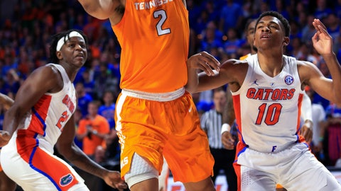 <p>               Tennessee forward Grant Williams (2) shoots next to Florida guard Noah Locke (10) during the first half of an NCAA college basketball game Saturday, Jan. 12, 2019, in Gainesville, Fla. (AP Photo/Matt Stamey)             </p>