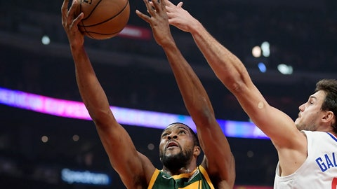 <p>               Utah Jazz forward Derrick Favors, left, shoots as Los Angeles Clippers forward Danilo Gallinari defends during the first half of an NBA basketball game, Wednesday, Jan. 16, 2019, in Los Angeles. (AP Photo/Mark J. Terrill)             </p>
