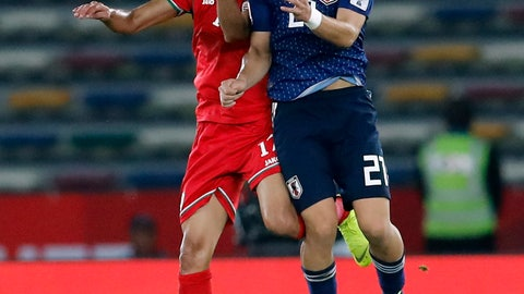 <p>               Japan's midfielder Ritsu Doan, right, goes for a header with Oman's midfielder Ahmed Al Mahaijri during the AFC Asian Cup group F soccer match between Japan and Oman at Zayed Sports City Stadium in Abu Dhabi, United Arab Emirates, Sunday, Jan. 13, 2019. (AP Photo/Hassan Ammar)             </p>