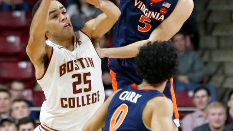 <p>               Boston College guard Jordan Chatman (25) passes the ball away from Virginia guards Kyle Guy (5) and guard Kihei Clark (0) during the first half of an NCAA basketball game Wednesday, Jan. 9, 2019, in Boston. (AP Photo/Mary Schwalm)             </p>
