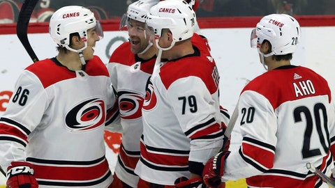<p>               Carolina Hurricanes' Justin Williams (14) celebrates his winning goal against the Ottawa Senators with teammates Teuvo Teravainen (86) Michael Ferland (79) and Sebastian Aho (20) during third-period NHL hockey play in Ottawa, Ontario, Sunday, Jan. 6, 2019. (Fred Chartrand/The Canadian Press via AP)             </p>