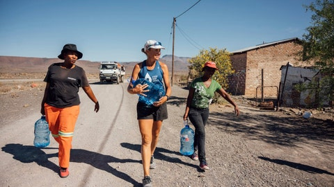 <p>               In this Monday, Dec. 31, 2018 photo supplied by Flux Communications, Mina Guli, an Australian activist seeking to highlight global water shortages, walks through drought-stricken Beaufort West, in South Africa. Guli is struggling to complete 100 marathons in 100 days across the world. Now in South Africa, 48-year-old Guli is more than half-way through the punishing project, but she's injured and a spokeswoman said Wednesday, Jan. 2, 2019 that the advocate will walk the rest of the marathons. (Kelvin Trautman, Flux Communications via AP)             </p>