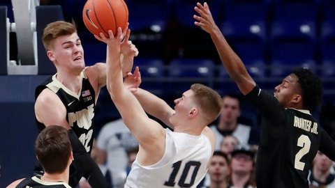 <p>               Penn State's Kyle McCloskey (10) shoots between Purdue's Matt Haarms, left, and Eric Hunter Jr. (2) during the first half of an NCAA college basketball game Thursday, Jan. 31, 2019, in State College, Pa. (AP Photo/Keith Srakocic)             </p>