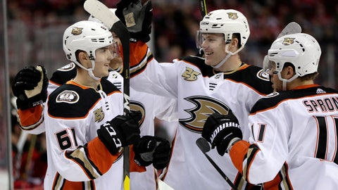 <p>               Anaheim Ducks players celebrate a goal by right wing Troy Terry, left, during the first period of an NHL hockey game against the New Jersey Devils, Saturday, Jan. 19, 2019, in Newark, N.J. (AP Photo/Julio Cortez)             </p>