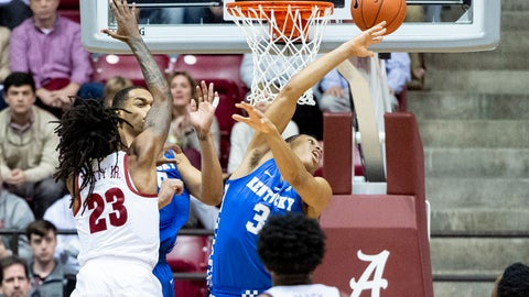 <p>               Kentucky guard Keldon Johnson (3) swats away a rebound from Alabama guard John Petty (23) during the first half of an NCAA college basketball game, Saturday, Jan. 5, 2019, in Tuscaloosa, Ala. (AP Photo/Vasha Hunt)             </p>