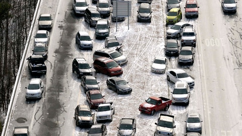 <p>               FILE-In this Jan. 29, 2014 aerial file photo, abandoned cars at I-75 headed northbound near the Chattahoochee River overpass are piled up in the median of the ice-covered interstate after a winter snow storm, in Atlanta. A winter storm watch goes into effect at 4 a.m. Tuesday, Jan. 29, for Atlanta, a city known for its ability to grind to a halt even in relatively light snowfalls. (AP Photo/David Tulis, File)             </p>