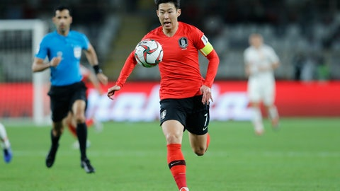 <p>               South Korea's forward Son Heung-Min runs with the ball during the AFC Asian Cup group C soccer match between South Korea and China at Al Nahyan Stadium in Abu Dhabi, United Arab Emirates, Wednesday, Jan. 16, 2019. (AP Photo/Hassan Ammar)             </p>