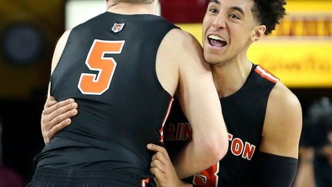 <p>               File- This Dec. 29, 2018, file photo shows Princeton guard Devin Cannady, right, and teammate Drew Friberg (5) celebrating following a victory over Arizona State in an NCAA college basketball game, in Tempe, Ariz.  Cannady has been suspended from the Princeton University basketball team after throwing a punch at a campus police officer and being arrested following a confrontation at a convenience store. (AP Photo/Ralph Freso, File)             </p>