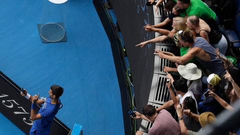 <p>               Serbia's Novak Djokovic takes a selfie with spectators as he practices on Rod Laver Arena ahead of his men's singles final against Spain's Rafael Nadal at the Australian Open tennis championships in Melbourne, Australia, Sunday, Jan. 27, 2019.(AP Photo/Mark Schiefelbein)             </p>
