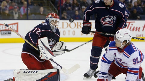 <p>               Columbus Blue Jackets' Sergei Bobrovsky, left, of Russia, makes a save in front of teammate Scott Harrington, center, and New York Rangers' Vladislav Namestnikov, also of Russia, during the first period of an NHL hockey game Sunday, Jan. 13, 2019, in Columbus, Ohio. (AP Photo/Jay LaPrete)             </p>