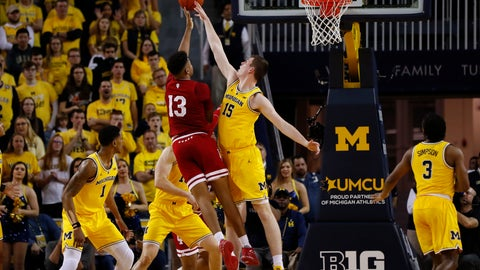 <p>               Indiana forward Juwan Morgan (13) shoots against Michigan center Jon Teske (15) in the second half of an NCAA college basketball game in Ann Arbor, Mich., Sunday, Jan. 6, 2019. (AP Photo/Paul Sancya)             </p>