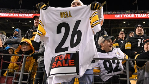 <p>               FILE - In this Nov. 8, 2018, file photo, a Pittsburgh Steelers fan holds a Le'Veon Bell jersey during the second half of an NFL football game between the Steelers and the Carolina Panthers in Pittsburgh. The steady exodus of mid-level veterans from the NFL is one element of a long-standing tension between players and the league over the structuring of contracts. The contract holdouts by Bell and Earl Thomas this season put the issue into vivid focus. (AP Photo/Don Wright, File)             </p>