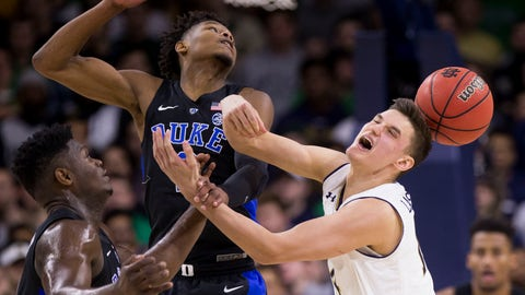 <p>               Duke's Zion Williamson, left, and Cam Reddish, center, compete for the ball with Notre Dame's Nate Laszewski (14) during the first half of an NCAA college basketball game Monday, Jan. 28, 2019, in South Bend, Ind. (AP Photo/Robert Franklin)             </p>