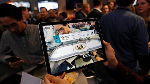 <p>               People watch real-time puck and player tracking technology on display during an NHL hockey game between the Vegas Golden Knights and the San Jose Sharks in Las Vegas, Thursday, Jan. 9, 2010. The NHL for the first time has tested real-time puck and player tracking in regular-season games with the aim of having it ready for the 2019-20 season. Microchips were added to players' shoulder pads and fitted inside specially designed pucks for two Vegas Golden Knights home games this week: Tuesday against the New York Rangers and Thursday against the San Jose Sharks. Antennas stationed around the arena tracked the players and the puck through radio frequencies and beamed the data to a suite where league and Players' Association executives and representatives from 20 teams and various technology firms, sports betting companies and TV rights holders were on hand for the two nights of testing. (AP Photo/John Locher)             </p>
